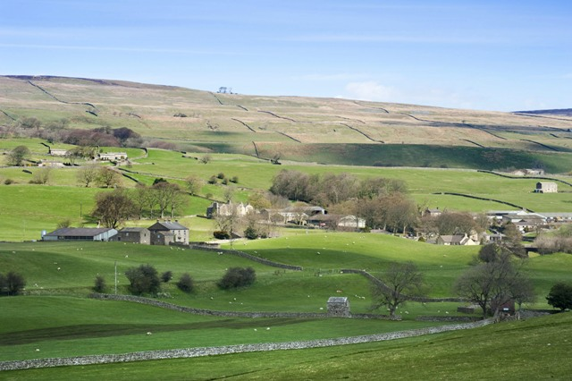 a patchwork a fields and farm buildings in the yorkshire dales