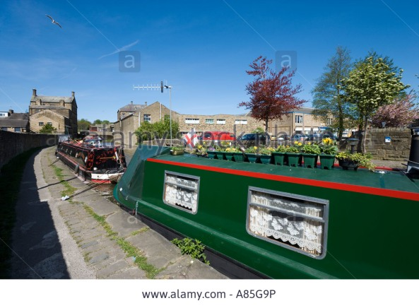 narrowboat with curtains and flower pots