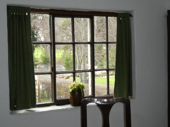 Looking through the latticed window to the herb garden.