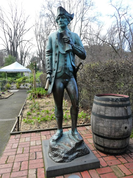 Life-sized statue of Captain Cook in the herb garden